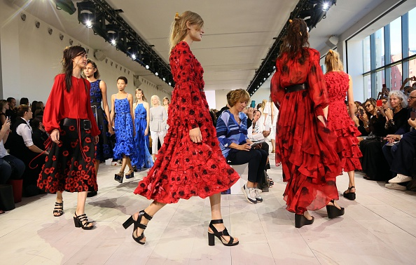Models walk the runway during the Michael Kors presentation at New York Fashion Week on September 16, 2015 in New York. AFP PHOTO/TREVOR COLLENS (Photo credit should read TREVOR COLLENS/AFP/Getty Images)