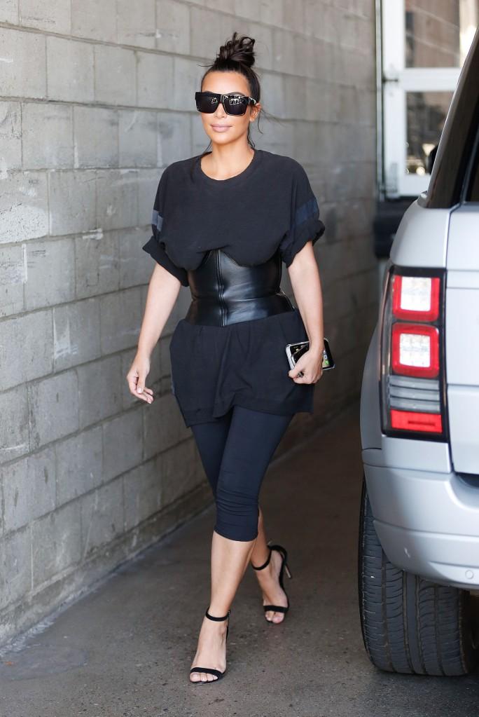 A happy Kim Kardashian arrives for a photo shoot at Milk Studios